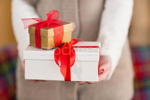 Woman with nail varnish holding gifts Stock photo © wavebreak_media
