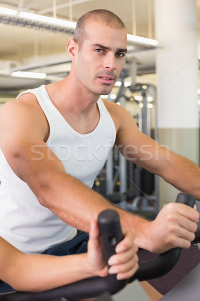 Man working out on exercise bike at gym Stock photo © wavebreak_media