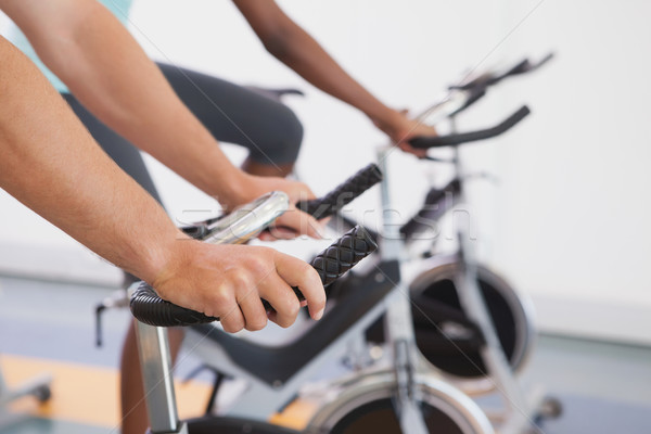 Fitt emberek dolgoznak ki testmozgás biciklik tornaterem Stock fotó © wavebreak_media