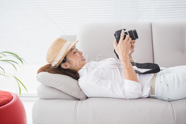 Photo editor looking at her camera Stock photo © wavebreak_media
