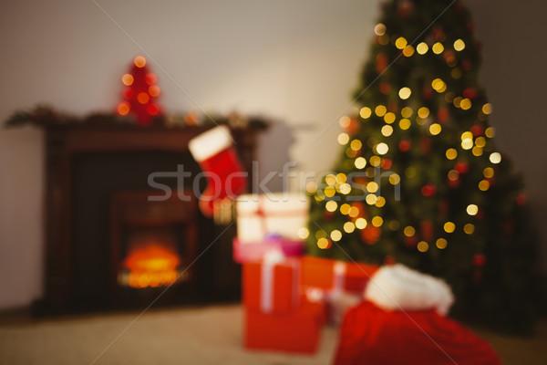 Kerstboom presenteert haard home woonkamer huis Stockfoto © wavebreak_media