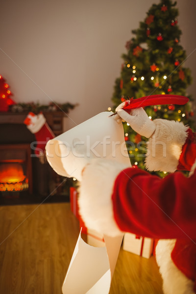 Father christmas writing with a quill Stock photo © wavebreak_media