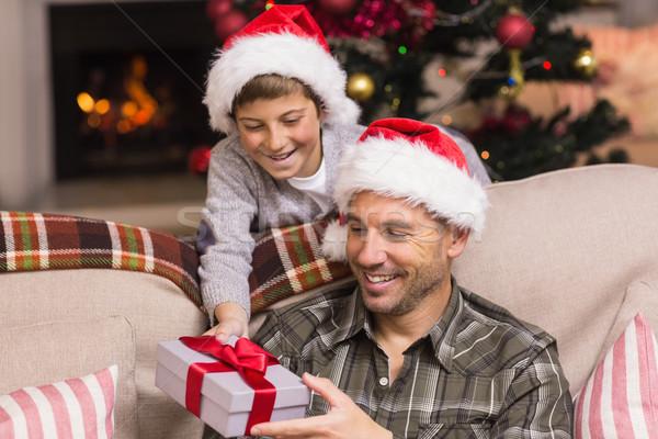 сын предлагающий отец Рождества подарок диване Сток-фото © wavebreak_media
