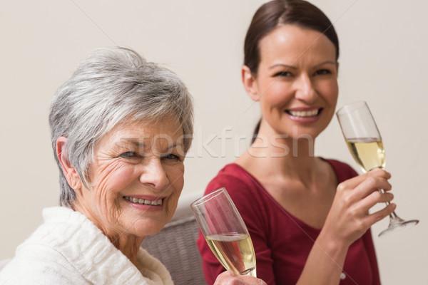 Sonriendo mujeres vidrio champán casa Foto stock © wavebreak_media