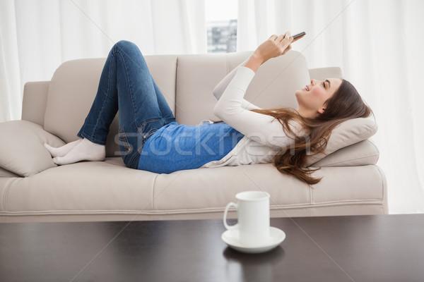 Ziemlich Brünette Text Couch home Stock foto © wavebreak_media