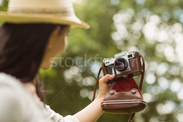 Brunette in straw hat taking a selfie with retro camera Stock photo © wavebreak_media