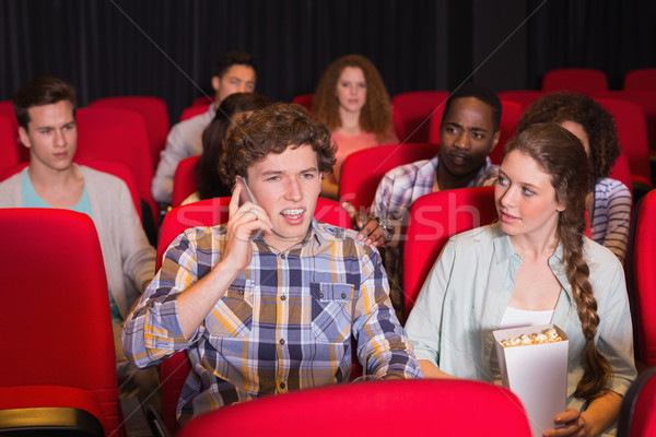 Annoying man on the phone during movie Stock photo © wavebreak_media