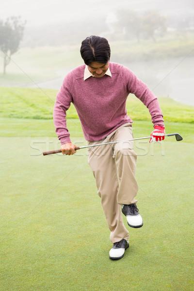 Angry golfer trying to brake his club  Stock photo © wavebreak_media