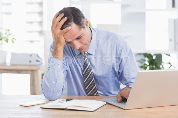 Frustrated businessman working in his office  Stock photo © wavebreak_media