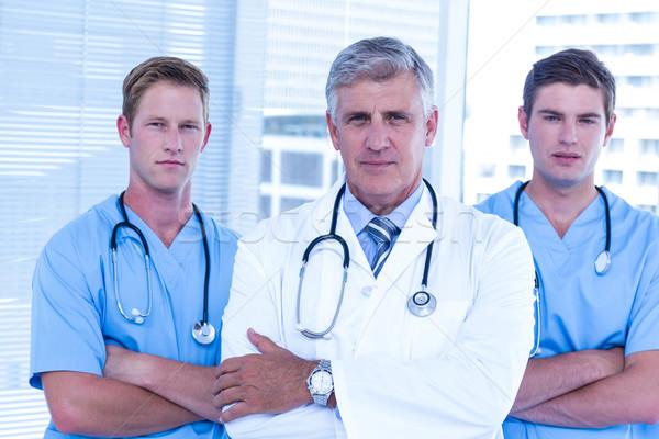 Medical team looking at camera Stock photo © wavebreak_media