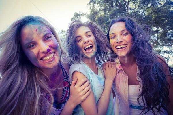 Heureux amis couvert poudre peinture Photo stock © wavebreak_media