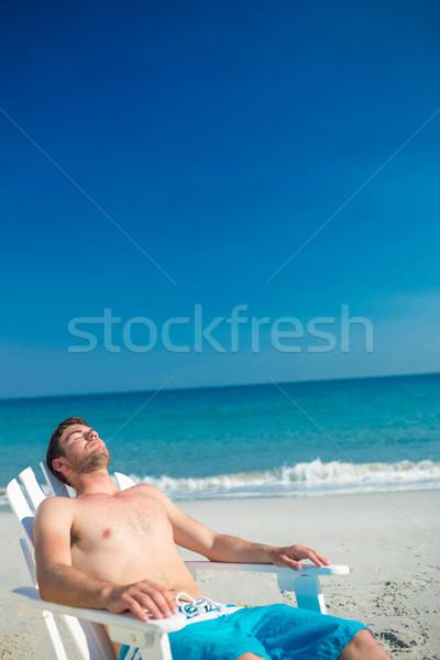 男 リラックス デッキ 椅子 ビーチ ストックフォト © wavebreak_media