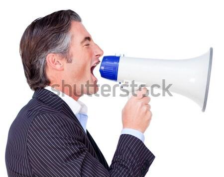 Pretty blonde speaking into megaphone Stock photo © wavebreak_media