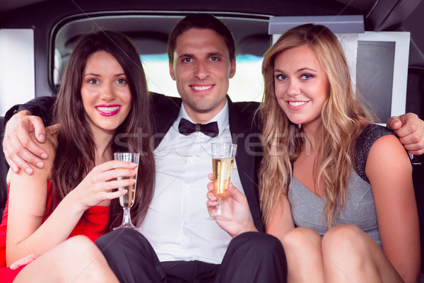Pretty girls with ladies man in the limousine Stock photo © wavebreak_media