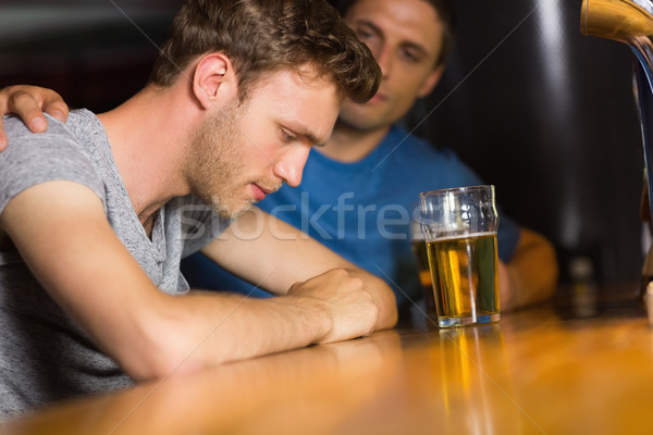 Caring friend comforting upset man  Stock photo © wavebreak_media