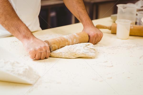 Baker rolling dough at a counter Stock photo © wavebreak_media