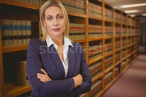 Serious woman standing with arms crossed Stock photo © wavebreak_media