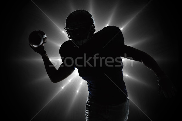 Composite image of silhouette sportsman throwing football Stock photo © wavebreak_media
