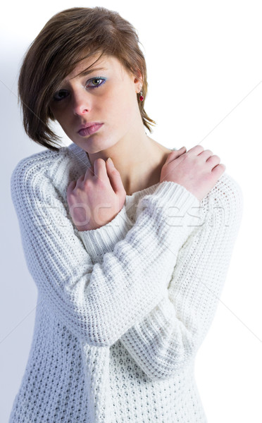 Sad pretty brunette looking at camera with arms crossed Stock photo © wavebreak_media