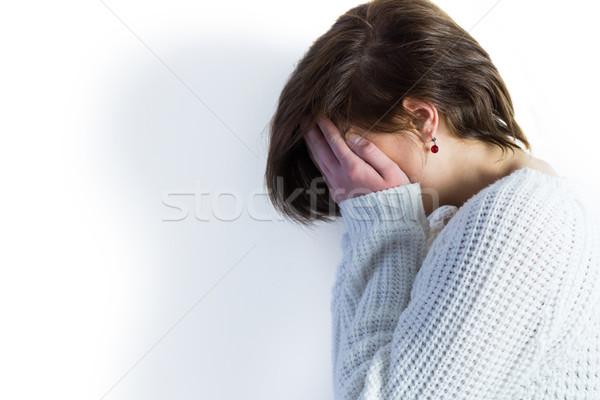 Triste joli brunette pleurer tête mains Photo stock © wavebreak_media
