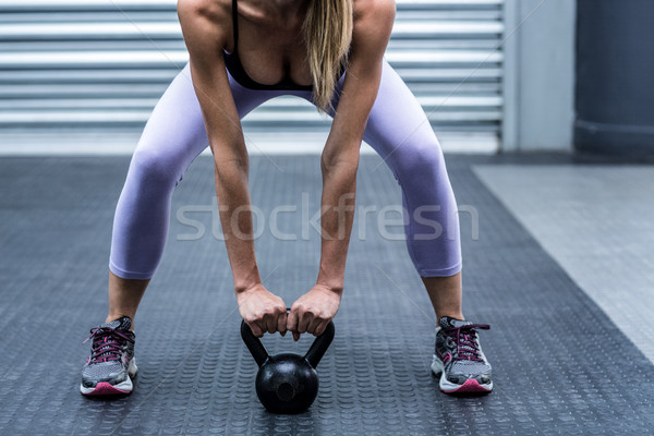 A muscular woman lifting kettlebells Stock photo © wavebreak_media