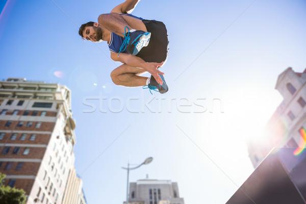 Handsome athlete jumping off the column Stock photo © wavebreak_media