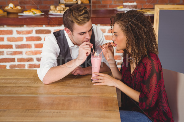 Cute couple sitting in cafe Stock photo © wavebreak_media