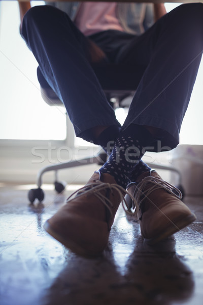 Low section of businessman sitting on chair at office Stock photo © wavebreak_media