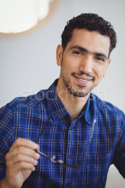 Portret uśmiechnięty wykonawczej okulary biuro Zdjęcia stock © wavebreak_media