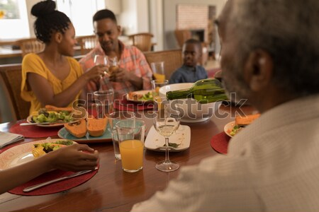 Man passing a meal plate to woman at table Stock photo © wavebreak_media