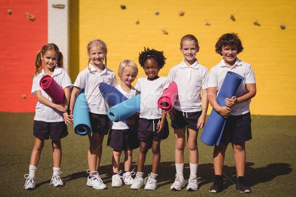 Retrato sorridente alunas em pé exercer menina Foto stock © wavebreak_media