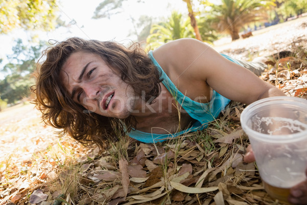 Unconscious man lying in the park Stock photo © wavebreak_media