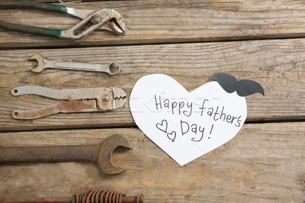 Overhead view of happy fathers day text by work tools on table Stock photo © wavebreak_media
