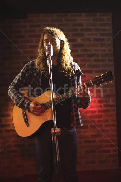 Male singer performing in nightclub Stock photo © wavebreak_media