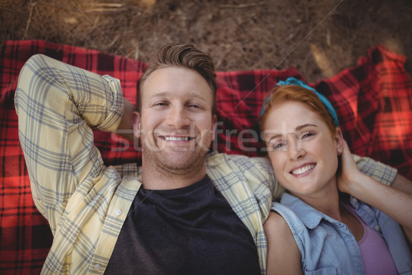 Overhead view of happy young couple resting on mat at farm Stock photo © wavebreak_media