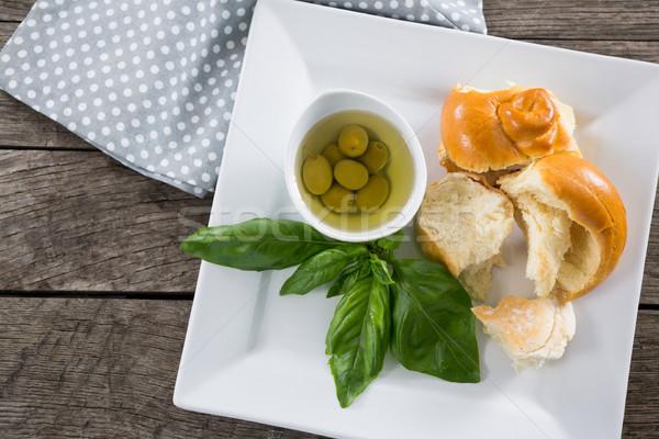 Olive erbe pane tavolo in legno frutta tavola Foto d'archivio © wavebreak_media