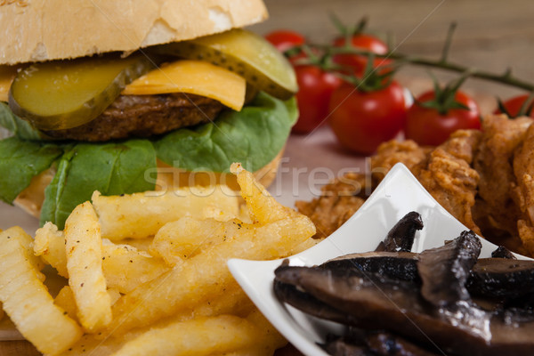 Hamburger and french fries on wooden table Stock photo © wavebreak_media