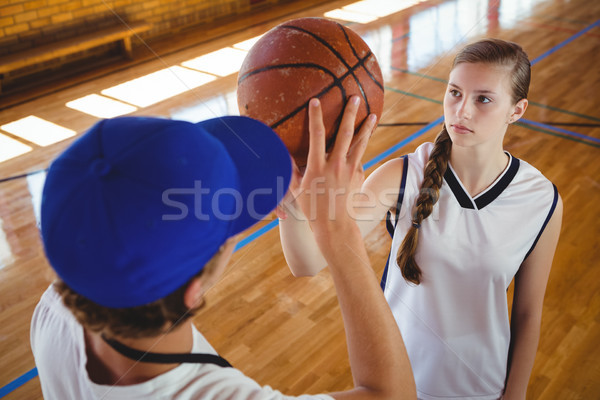 High angle view of male coach training female basketball player Stock photo © wavebreak_media