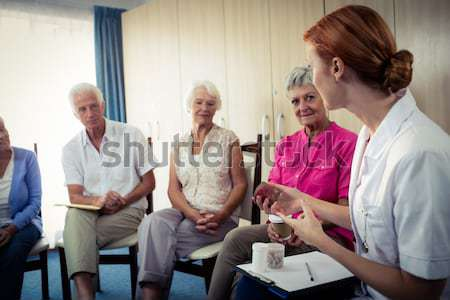 Female doctor explaining medicine to senior people Stock photo © wavebreak_media