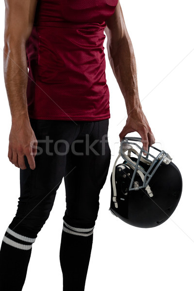Midsection of sportsperson holding helmet Stock photo © wavebreak_media
