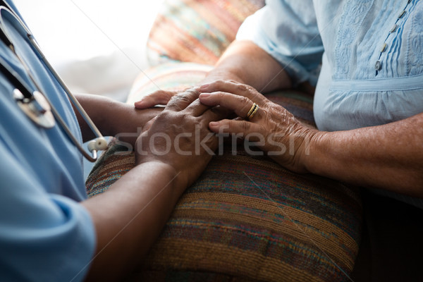 Midsection of nurse and patient relaxing at sofa Stock photo © wavebreak_media