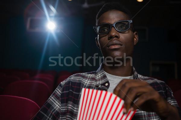 濃縮された 男 ポップコーン を見て 映画 劇場 ストックフォト © wavebreak_media