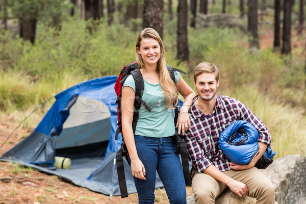 Portrait of a young pretty hiker couple holding a sleeping bag a Stock photo © wavebreak_media