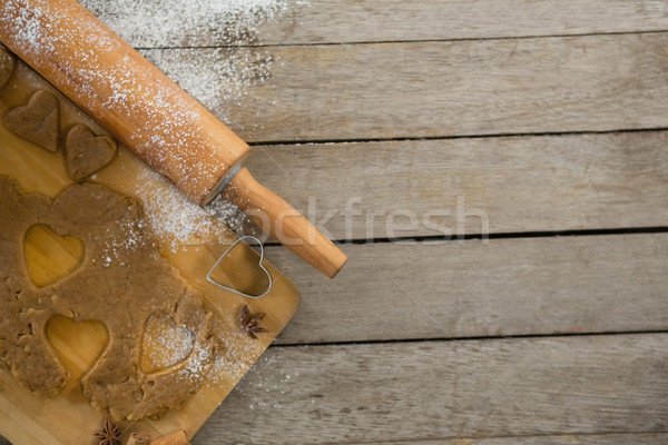 Overhead view of pastry dough on cutting board by rolling pin Stock photo © wavebreak_media