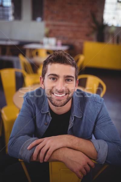 Ritratto sorridere bell'uomo seduta sedia coffee shop Foto d'archivio © wavebreak_media