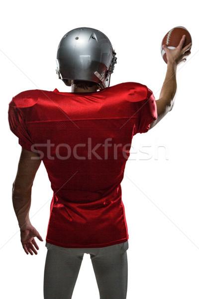 Rear view of sportsman in red jersey holding ball Stock photo © wavebreak_media