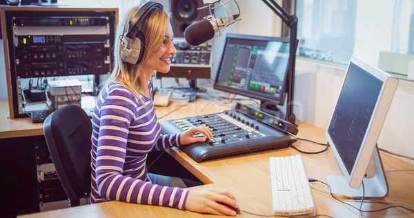 Female radio host broadcasting through microphone Stock photo © wavebreak_media