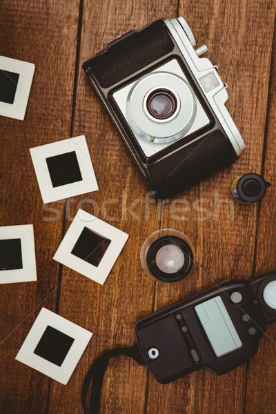 View of an old camera with photos slides Stock photo © wavebreak_media