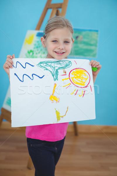 Happy kid enjoying arts and crafts painting Stock photo © wavebreak_media