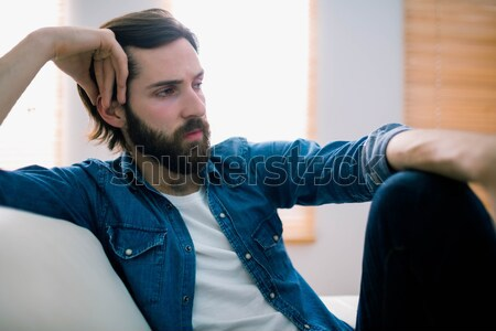 Unahppy man thinking on his sofa Stock photo © wavebreak_media